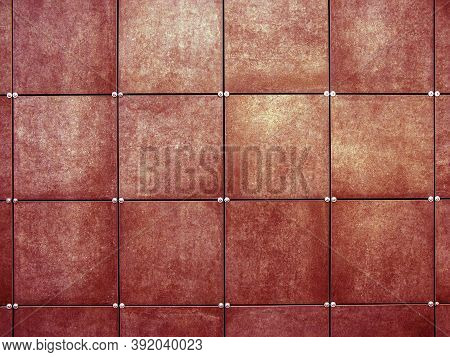The Wall Is Covered With Red Square Tiles. Modern Wall Design. Exterior Decoration Of The Walls Of T