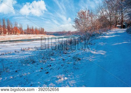 Embankment Of The River In Winter. Cityscape On A Sunny Day. Reflection On The Water