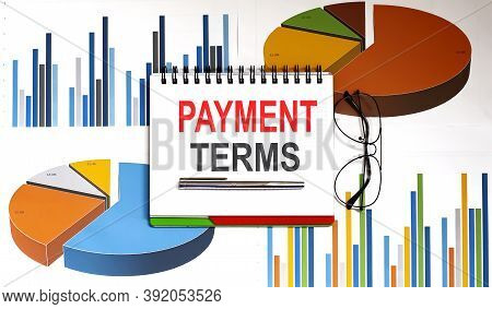 Payment Terms .conceptual Background With Charts And Papers And Glasses,business
