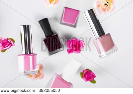 Beauty Cosmetics Makeup Product Flying. Womens Makeup, Nail Polish And Flower Fall In The Air. Cosme