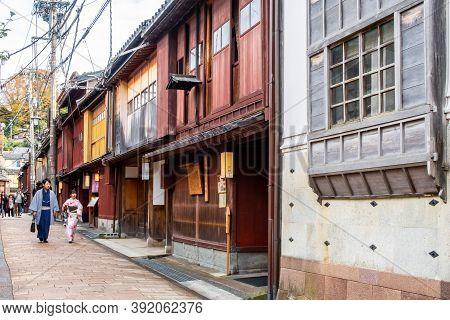 Kanazawa, Japan, 09/11/19. Higashi Chaya Geisha District With Old Wooden Houses And Tourists Walking