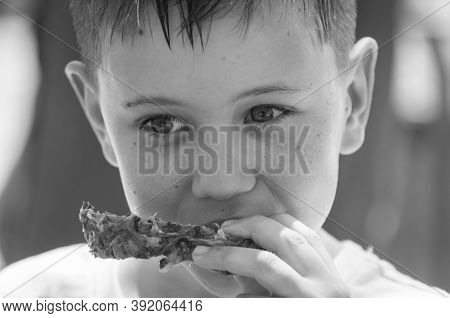 Cute Caucasian 8 Year Old Boy Eating Pineapple Black And White Close Up Portrait Image.