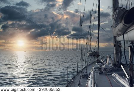 Fragment Of Luxury Wealthy Yacht In The Mediterranean Sea During Bright Picturesque Sunset, Glowing