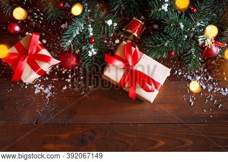 Christmas Greeting Card Concept. Gifts Box With Christmas Tree And Decoration On Wooden Background.