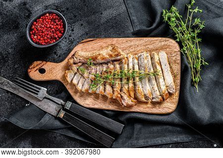 Sliced Grilled Pork Cutlets. Organic Meat Steak. Black Background. Top View