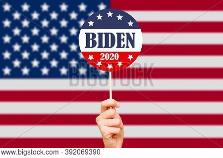 Joe Biden Campaign Button On The Background Of The Usa Flag. Election Of The President Of The United