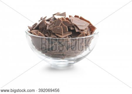 Grated dark chocolate in bowl. Chocolate flakes isolated a on white background.
