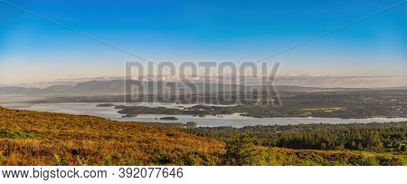 Panoramic View Of Lough Leane With Ross Island And Castle On A Sunny Foggy Summer Morning. Killarney