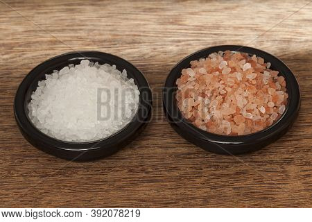 Salt; Himalayan Pink Salt Crystals And Sea Salt, Photo On Wooden Background.