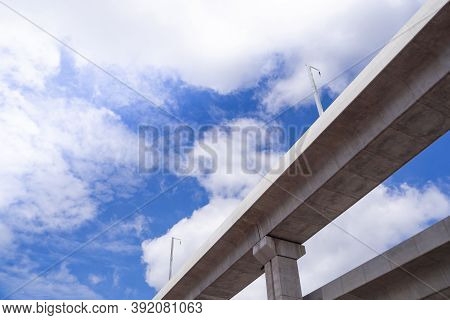 Bottom View Of Bts Skytrain Tracks In Bangkok, Thailand. With Beautiful Sky And Clouds Background. B