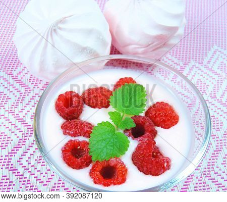 Fresh Raspberries With Mint, Yogurt And Marshmallows. Desserts On A Patterned Wicker Surface