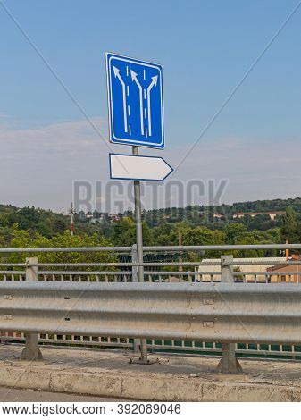 Blue Traffic Sign Direction Board At Overpass