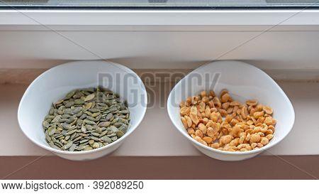Peanuts And Pumpkin Seeds Healty Snacks In Bowls