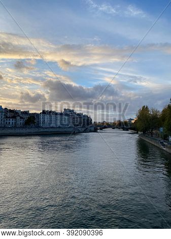 Romantic view of Paris from a bridge over the river the Seine