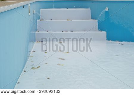 Backyard Swimming Pool With Stairs Emptied Out Shutting Down For Winter