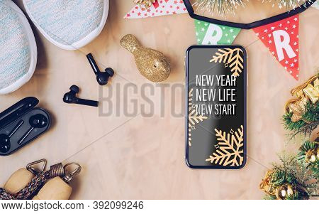 New Year Resolutions  Healthy Goals Background Concept. New Year New Life New Start Text On Mobile P