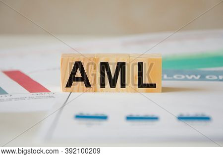 Money Laundering Concept. Aml - Anti-money Laundering - Acronym For Wooden Cubes. The Word Is Writte