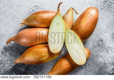 Raw Shallot Onions, Cut In Two Halves. Gray Background. Top View