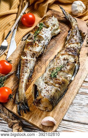 Delicious Grilled Pollock With Fresh Thyme And Tomatoes. White Background. Top View