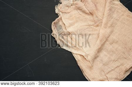 Beige Gauze Kitchen Napkin On Black Background, Top View