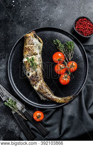 Delicious Grilled Pollock With Fresh Thyme And Tomatoes. Black Background. Top View