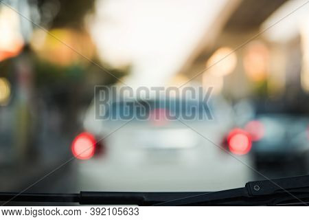 Blur Abstract Background, Unrecognizable Silhouettes Of A Blur Of City Traffic