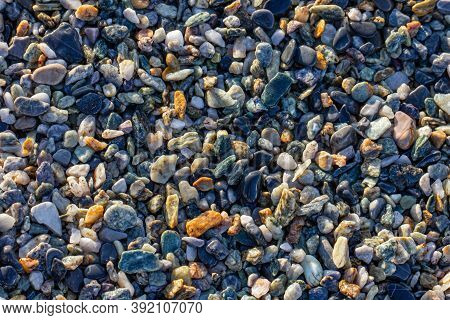 Abstract Nature Pebbles Background. Wet Pebbles Texture.