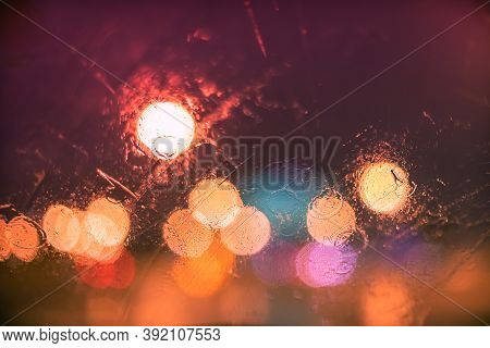 Abstract Bokeh Blur Background By Rain Drops On Glass Window At Night In The City