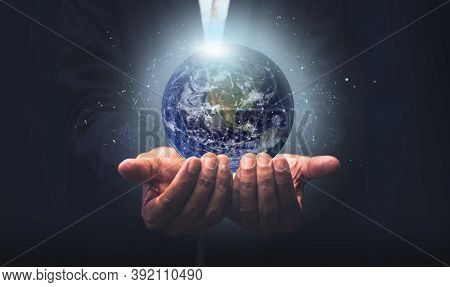 Businessman Holding The Earth With Global Connection Concept. Energy Saving Concept, Elements Of Thi