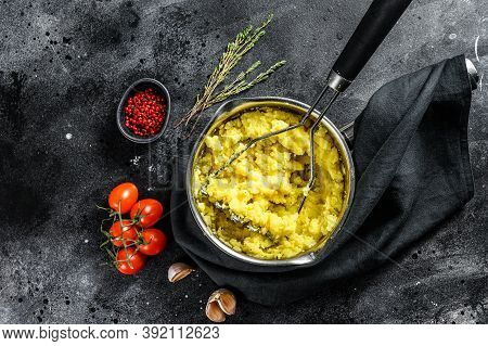 Cooking Mashed Potatoes In A Pot. Black Background. Top View