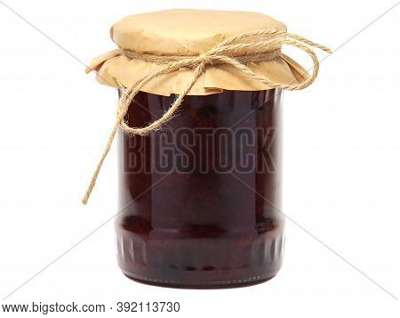 Plum Jam In A Glass Jar Isolated On White Background