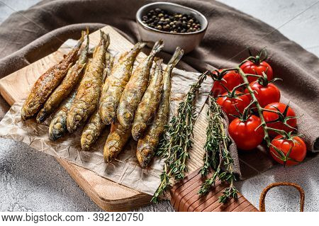 Grilled Smelt Fish. Delicious Appetizer. Gray Background. Top View
