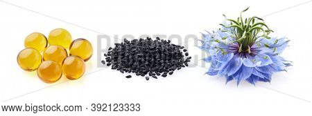 Black cumin capsules oil. Black cumin seeds. Nigella sativa flower.