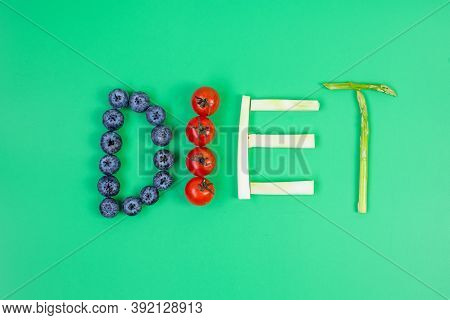 Diet Arrangement Of Fruit And Vegetable; Blueberries, Cherry Tomatoes, Broccoli And Asparagus On Gre
