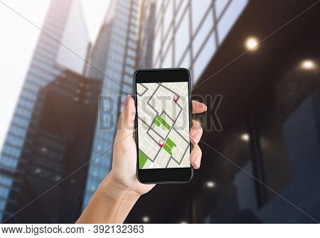 Female Hand Holding Smartphone With Offline Map Searching Way, Making Route Using Gps Navigation App