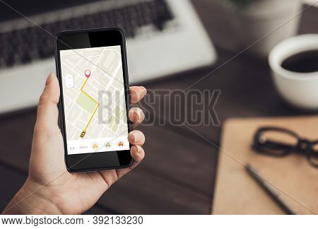 Businesswoman With Smartphone Booking Taxi Online Via Mobile App Commuting From Work Sitting In Mode
