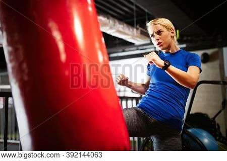 Boxing Training Woman With Punching Kicking Bag In Gym