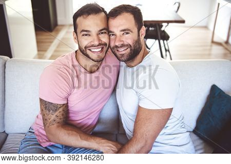 Portrait Of A Cute Male Gay Couple At Home