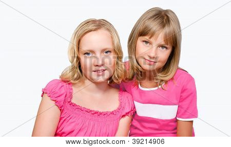 Two Smiling Preteen Girls Isolated Over White Background