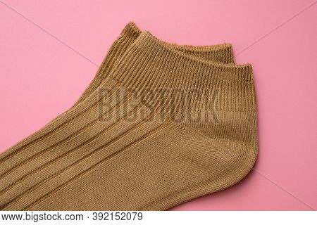 Cotton Socks On A Pink Background Top View. Short Brown Socks, Elastic Band Closeup. Soft Socks For