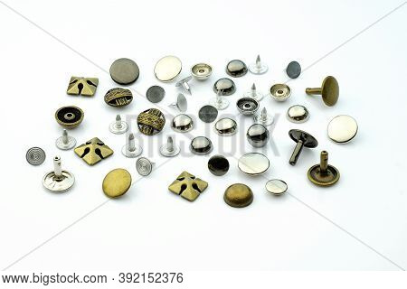 Rivets For Leather And Fabric Of Different Sizes And Colors On A White Background. Holniten For The