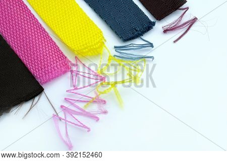Multicolored Textile Belts With Threads Sticking Out On A White Background. A Strap Tape That Slips.