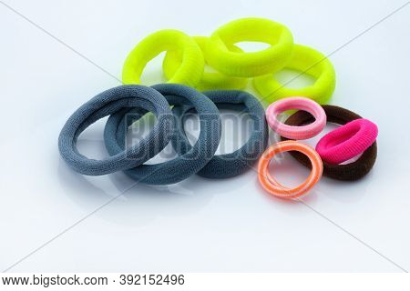 A Set Of Hair Bands On A White Background. Fabric Multi Colored Hair Ties. Hair Accessories. Ponytai