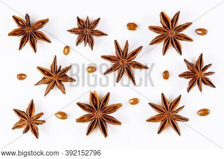Anise Star. Some Star Anise Fruits With Seeds. Close-up On White Background With Shadows, Flat Lay V