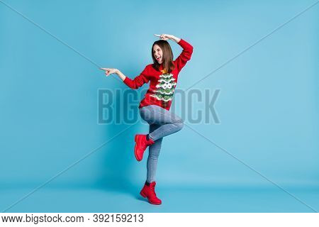 Full Length Body Size Photo Of Pretty Brunette Smiling Standing Tiptoe On One Leg Pointing With Fing