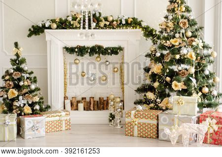 Christmas Decorated Interior - Bright Room With Fir-tree, Gift Boxes, Fireplace Decorated With Garla