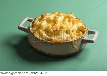 Close-up Of A Portion Of Mac And Cheese Baked In A Clay Plate. Home-baked Mac And Cheese Isolated On
