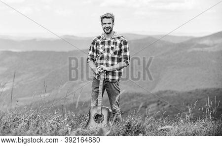 Hipster Musician. Inspiring Environment. Summer Music Festival Outdoors. Playing Music. Man Musician