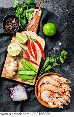 Homemade Tom Kha Gai. Coconut Milk Soup In A Bowl. Thai Food. Black Background. Top View