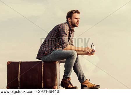 Luggage Concept. Travel With Luggage. Travel Blogger. Vacation Time. Travel Agency. Man Sit On Suitc